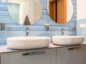 Two sinks in blue bathroom