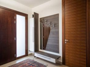 Hallway interior with wooden hanger and mirror